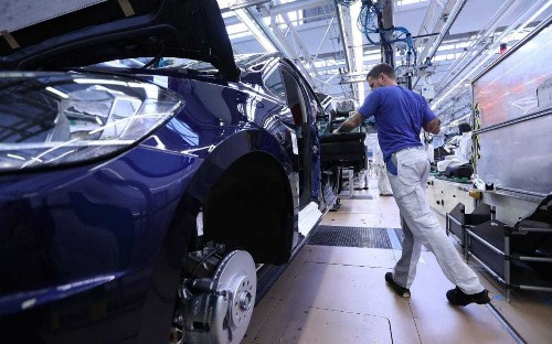 German economy goes into reverse gear as car industry struggles