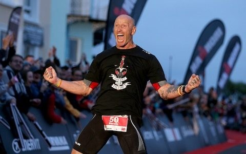 True sporting hero Gareth Thomas conquers both 140-mile Ironman and one of society's deepest prejudices