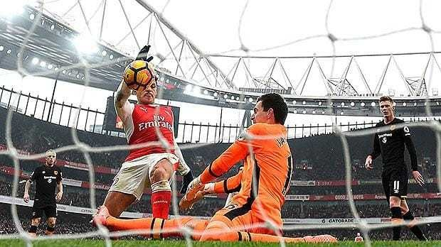 Arsenal 2 Hull City 0: Arsene Wenger tight-lipped about future as Alexis Sanchez gets Gunners back to winning ways