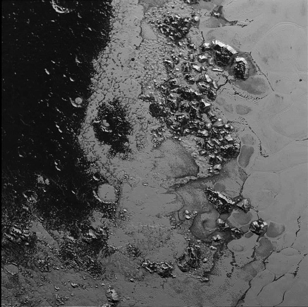 Twilight on Pluto: amazing images show ice mountains as night falls