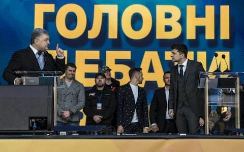Ukraine president and comedian challenger bring bitter election battle to grandiose stadium finale