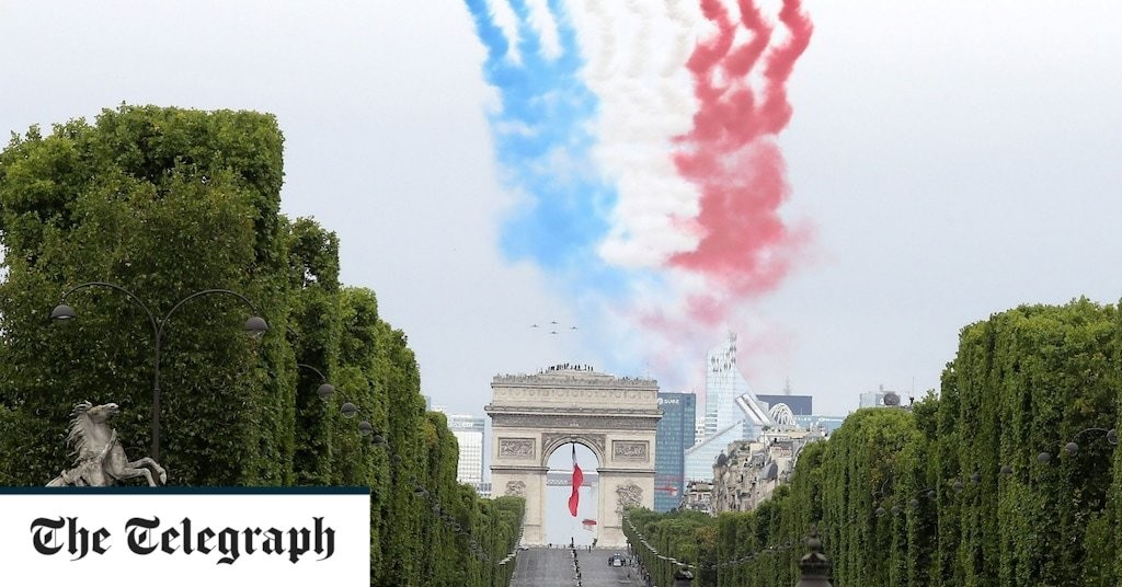 France pays Bastille Day tribute to front line health workers in downsized military parade