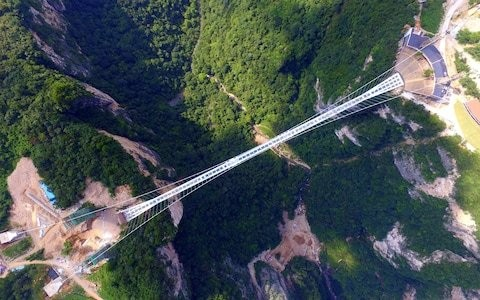 Don't look down - or perhaps do, if you dare...China opens world's highest, longest glass bridge
