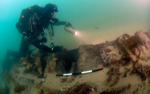 Excavation of first HMS Invincible reveals original hand cut water-level markers survived 200 years under the sea