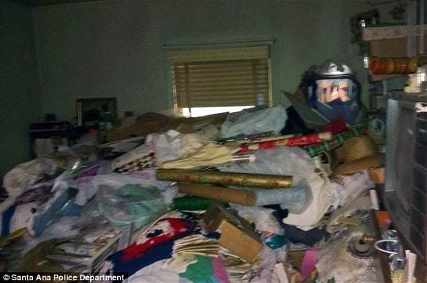 Hoarder dies after floor of her house collapses under weight