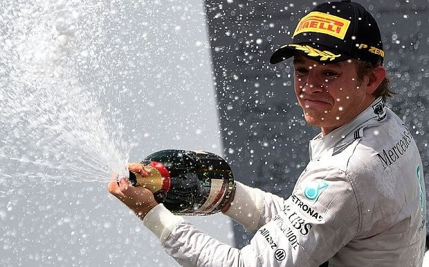 Brazil Grand Prix 2014: Nico Rosberg holds off team-mate Lewis Hamilton to set up dramatic season finale