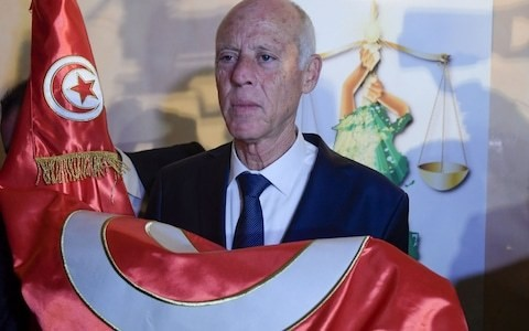 Conservative outsider candidate Kais Saied wins landslide in Tunisian presidential election