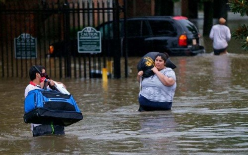 Coffins float down Louisiana's flooded streets as residents warned of snakes and disease