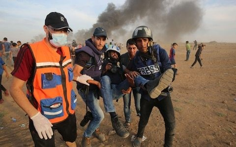 Israeli snipers targeted children, health workers and journalists in Gaza protests, UN says