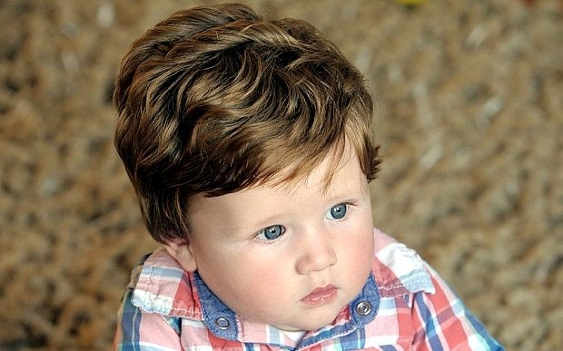 Baby boy boasting full head of hair has already had two haircuts at six months