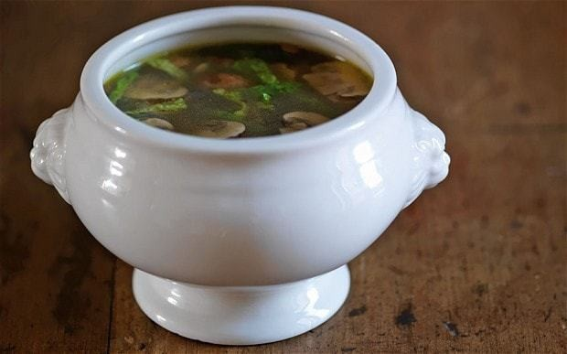 Mushroom broth with greens, sherry and pepper recipe