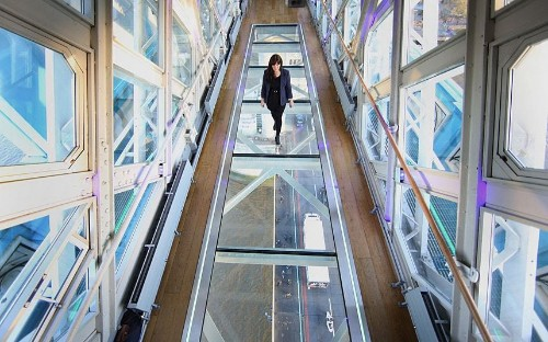 Tower Bridge unveils glass floor with spectacular views from the walkway  - Telegraph