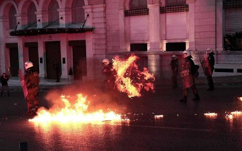 Greek parliament approves pension cuts and tax rises as protesters clash with police