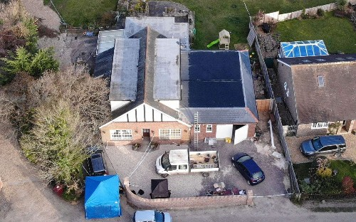 Police launch murder investigation after family of four is found dead at their £500,000 home