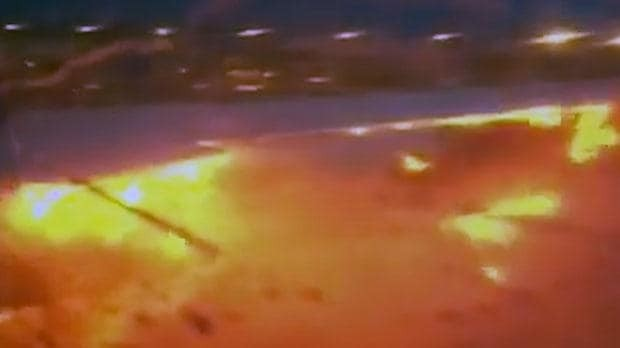 Fire on board Singapore Airlines plane filmed by passenger after aircraft makes emergency landing