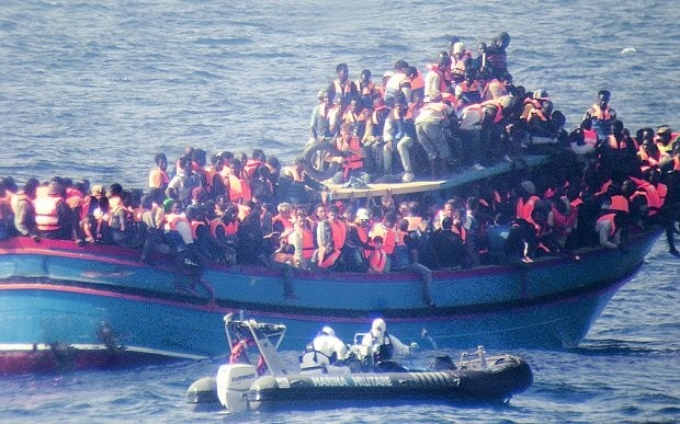 Trafficking gangs tip off Italian officials so that rescue services can pick up people-smuggling boats
