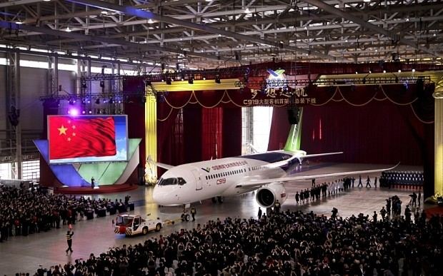 China unveils first domestically-produced large passenger jet, C919