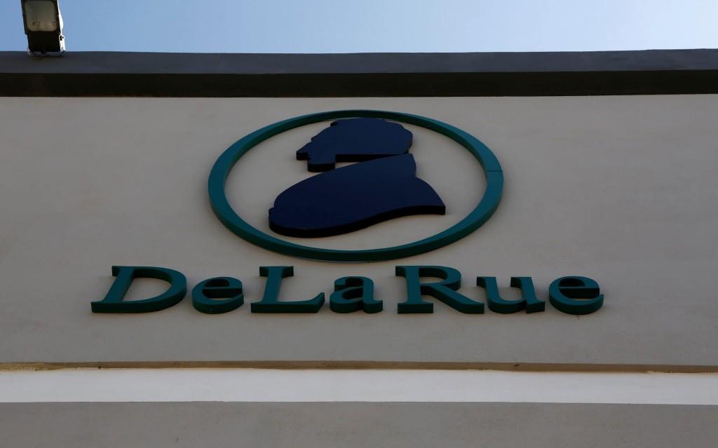 Market report: De La Rue jumps after booking deals
