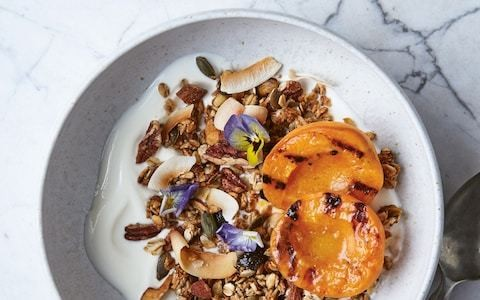 Coconut jumbo oat granola with charred stone fruit recipe