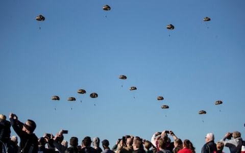 Battle of Arnhem anniversary: Prince of Wales watches mass parachute drop