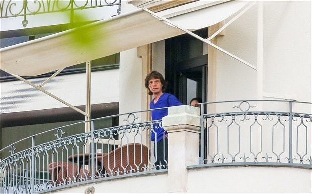 Sir Mick Jagger pictured with mystery woman