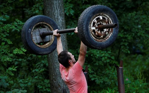 Wheel wellness: inspirational Russian fitness fans build makeshift gym from car parts