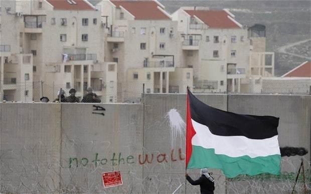 Israel approves new settler homes in east Jerusalem on eve of peace talks