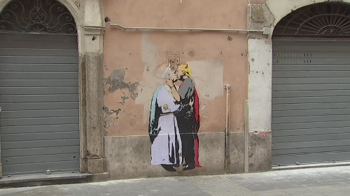 Mural of saintly Pope Francis kissing devilish Donald Trump appears in Rome