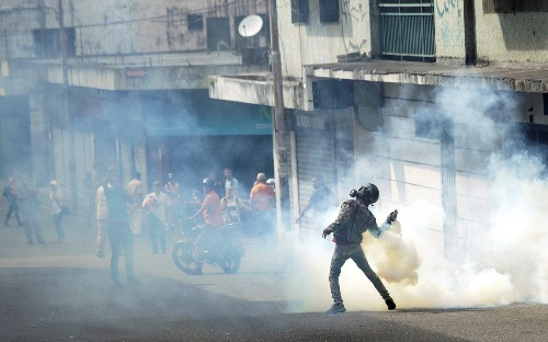 US refuses to pull out of Venezuela after Maduro dismisses diplomats amid deadly protests