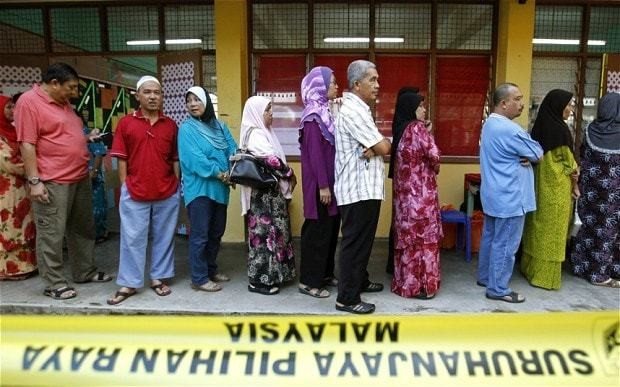 Malaysian ruling party triumphs as turnout hits record