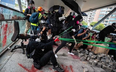 Hong Kong protester shot by police is arrested for unlawful assembly