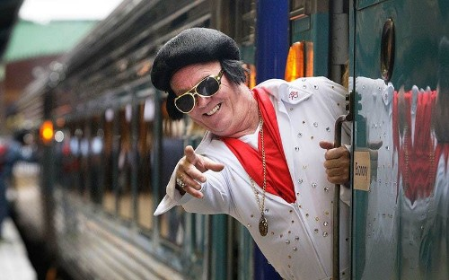 Elvis has left the station: Fans of The King travel by train to festival, in pictures