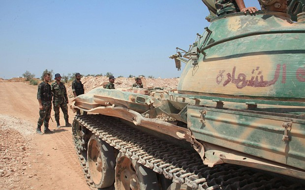 Kurdish fighters flush Isil from key town in Syria