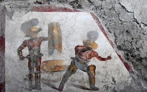 Archeologists find fresco of battling, bloodied gladiators in 2,000-year-old tavern in Pompeii