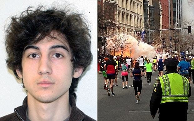 Boston Marathon bomber smiles as he is led into death sentence hearing