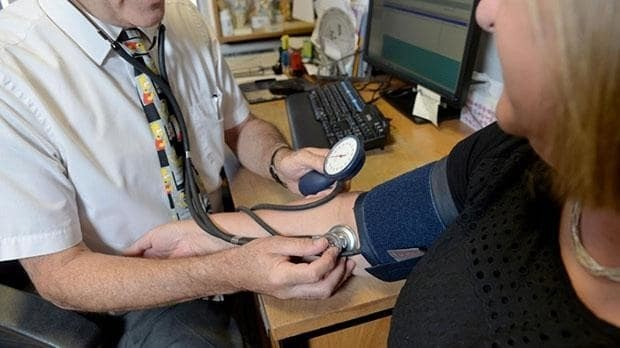 GPs' leaders hit back at Theresa May in row over extended opening hours amid growing A&E crisis