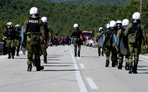Riot police clash with residents on Greek islands over new migrant camps