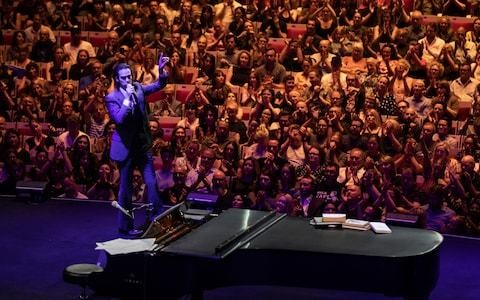 Conversations with Nick Cave, Barbican, review: a spiky, funny, beautiful evening with a genuine one-off