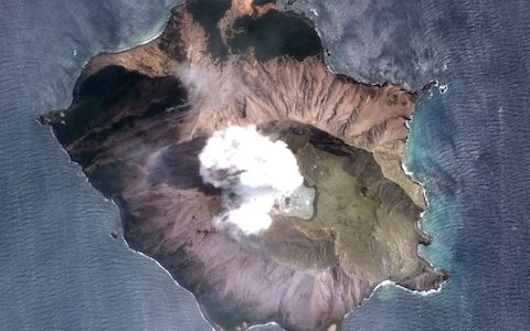Plans for dangerous mission to recover bodies from volcanic island in New Zealand despite eruption risk