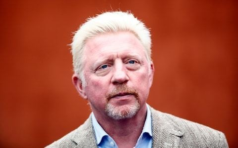 Boris Becker caught by police officer sending text at wheel while not wearing seatbelt