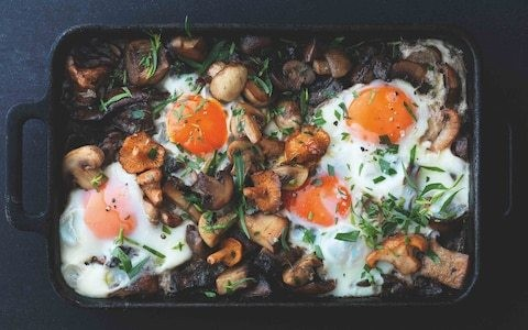 Pan-fried mushrooms with baked eggs and tarragon recipe
