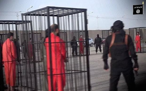 Islamic State releases a new video parading Peshmerga forces in cages