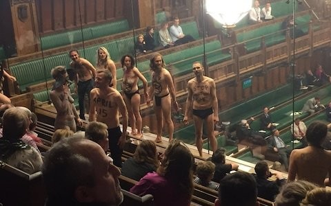 A dozen climate change protesters arrested after stripping off in Commons
