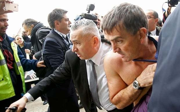 Air France bosses have shirts ripped from their backs as they escape furious employee mob