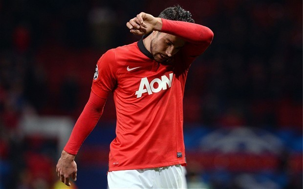 Robin van Persie ruled out of Manchester United squad for a month with a thigh injury
