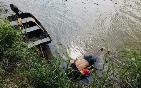 Shock over image of migrant father drowned in Rio Grande with toddler clutching him