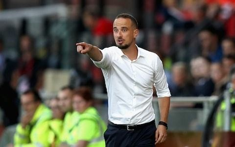 Police investigate physical threats to Mark Sampson in run up to colleague's racism allegation