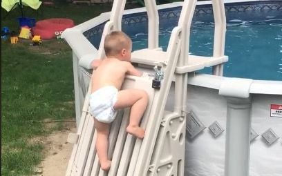 Parents capture video of two-year-old scaling an 'unclimbable' pool ladder