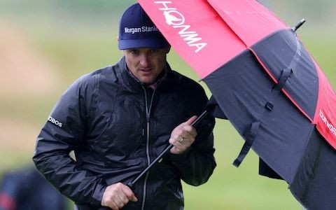 Wet and windy weather hits Royal Portrush - but Open spectators and caddies are well prepared
