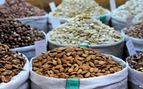 Eating a handful of nuts twice a week can slash the risk of heart disease